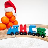Holidays, winter and celebration concept - Christmas composition Russian wooden letters train cars the word New Year on wood railw. Ay fir tree and white royalty free stock photography