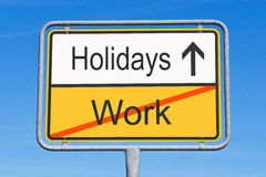 Holidays instead of work. A traffic sign with the concept of end of work and direction to the holidays Stock Image