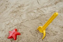 Holidays written in sand. Word holidays written in sand. Concept of happy summer holiday Stock Photo