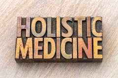 Holistic medicine - word abstract in wood type. Holistic medicine - word abstract in vintage letterpress wood type printing blocks royalty free stock image