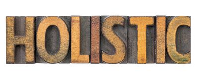 Holistic - word abstract in wood type. Holistic - isolated word abstract in vintage letterpress wood type blocks royalty free stock photos