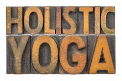 Holistic yoga word abstract in wood type. Holistic yoga word abstract - isolated text in letterpress wood type printing blocks stained by color inks Royalty Free Stock Images