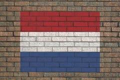 Holländische Markierungsfahne auf Wand Stockfotos