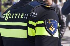 Holländsk polis i steetsna av Haag royaltyfri fotografi