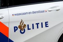 Holländsk polislogo och slogan på en bil royaltyfria foton