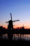 Holland. Silhouette of dutch old windmills during sunset Royalty Free Stock Photography