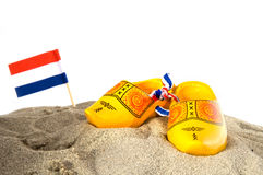 Holland. With flag and wooden shoes at the beach stock photos