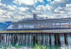 Holland America in Juneau. JUNEAU, ALASKA- May 31, 2016:  The City of Juneau is the capital city of Alaska. Juneau`s population can increase by roughly 6,000 stock images