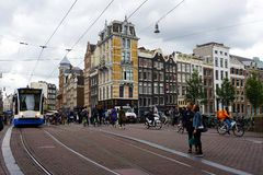 Holland, Amsterdam, the city streets with its typical palaces. Amsterdam, the city streets with its typical palaces Stock Photo