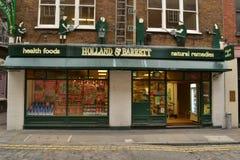 Holland & Barrett shop Seven Dials London. Holland & Barrett shop in Seven Dials London.  Part of a chain of health food stores Stock Photos