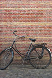 Holland bike. Typical Holland bike leaning against a wall in Alkmaar Royalty Free Stock Photos