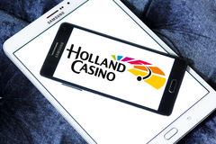 Holland Casino logo. Logo of Holland Casino on samsung mobile. Holland Casino has the legal monopoly on gambling in the Netherlands, and has fourteen casinos Royalty Free Stock Images