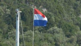 Holland Flag on Mast. Netherlands flag on ship mast stock video footage