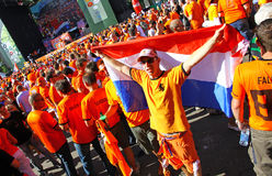 Holland football fans walk on a street of Kharkiv Royalty Free Stock Images