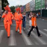 Holland football team supporters. KHARKIV, UKRAINE - 09 JUNE: Holland football team supporters walk on a street of Kharkiv city before UEFA EURO 2012 game Royalty Free Stock Photos
