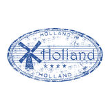 Holland grunge rubber stamp. Blue grunge rubber stamp with windmill and the name of Holland written inside the stamp Stock Image