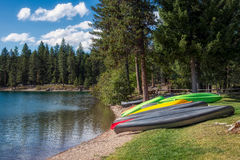 HOLLAND LAKE, MONTANA/USA - SEPTEMBER 19 : Canoes Beached at Lak Stock Photo