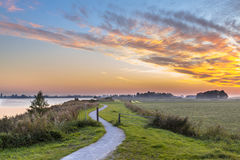 Holland landscape with winding cycling track Royalty Free Stock Photos