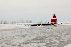 Holland lighthouse. In the winter at Holland State Park in Ottawa County MI stock photography