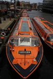 Typical dutch boats on the Amsterdam Canal royalty free stock photos