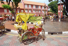 Holland Red Houses in Malacca. Holland Red Houses ,colorful rickshaw and  the plaza Malacca,Malaysia Royalty Free Stock Photos