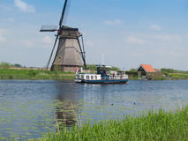 Holland rural windmill in Kinderdijk over water Stock Photography