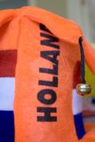 Holland Soccer Fan Hat. Closeup of the bell hanging off of a bright orange Holland soccer fan hat, with hat in softer focus in the background Stock Images