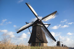 Holland windmill. Old mill chalk and flour . The beautiful backdrop of the countryside of Holland. Royalty Free Stock Photos