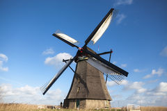 Holland windmill. Old mill chalk and flour . The beautiful backdrop of the countryside of Holland. Royalty Free Stock Photo
