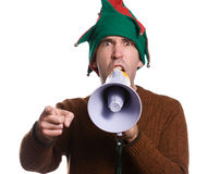 Hollering Elf. An adult elf is hollering into a megaphone and pointing with his finger Stock Image