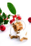 Hollies and gingerbreads Royalty Free Stock Images