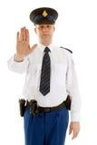 Holländische Polizeibeamte, die Endzeichen mit der Hand bildet Stockfotografie