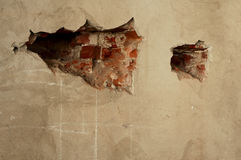 Hollow. In plaster of a brick wall Royalty Free Stock Photography