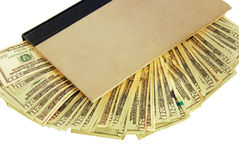Hollow book hiding money Stock Photo