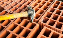 Hollow brick with hammer Stock Photography
