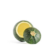 Hollow Eight Ball Zucchini. Eight ball squash with cut top and scooped out pulp isolated on white Royalty Free Stock Images