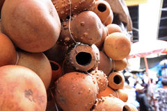 Hollow Gourds Hanging in a Market. Hollowed out gourds hang for sale in an African market Stock Photo