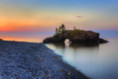 Hollow Rock Sunrise. A rocky outcropping along the shore of Lake Superior Royalty Free Stock Photos