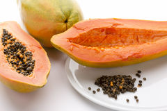 Hollowed Out Papaya Half And Its Peppery Seeds Stock Photography