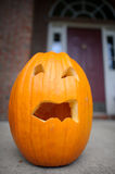 Holloween pumpkin on porch. Royalty Free Stock Images