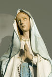Holly. Sculpture of virgin Mary stock images