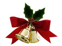 Holly and Bells. Christmas bells, holly and a red bow isolated on white stock photos