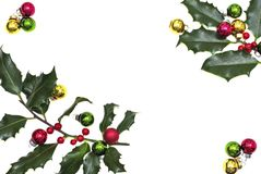 Holly berry and christmas balls Royalty Free Stock Photography