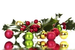 Holly berry and christmas balls Royalty Free Stock Photos