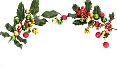 Holly berry and christmas balls. With copyspace Royalty Free Stock Photo