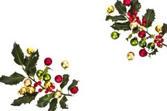 Holly berry and christmas balls Stock Photography