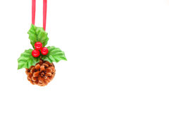 Holly berry and pine cone Royalty Free Stock Photo