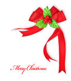 Holly berry and red ribbon, Christmas decoration Stock Photos