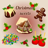 Holly berry and sweet Christmas desserts Royalty Free Stock Photography