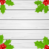 Holly berry on white wooden background Stock Image
